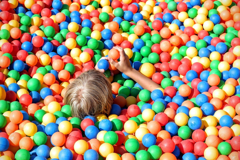 boy in ball pit